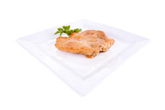 Chop breaded. Chop in breadcrumbs. on a plate. on a white background Royalty Free Stock Photography