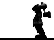Chop chop. Silhouette of wood-chopper carving Stock Photo