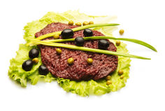 Chop meat decorated with onion, olive, and salad Royalty Free Stock Photography