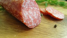 Falls chop the sausage black pepper with salami on a wooden, tomato. Chop the sausage with salami on a wooden   black pepper  falls stock footage
