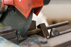 With chop saw cut metal piece. Using a metal, a metal piece is cut royalty free stock photography