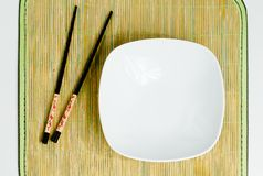 Chop sticks and a bowl Royalty Free Stock Photo