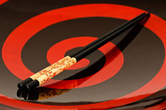 Chop sticks and a bowl. Two chop sticks on a beautiful black and red bowl Royalty Free Stock Image