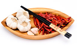 Chop sticks, chili fruit and garlic Royalty Free Stock Photo
