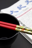 Chop sticks cup and newspaper Royalty Free Stock Photos