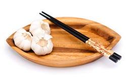 Chop sticks and garlic Stock Photos