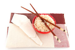 Chop sticks and rice in brown Royalty Free Stock Photo