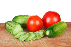 Chop tomatoes and cucumbers Stock Photo