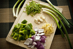 Chopboard With Vegetables. Chopped vegetables on a wooden chop board Royalty Free Stock Images