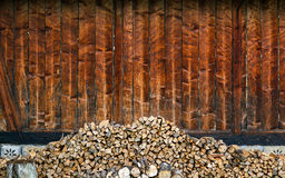 Choped firewoods near wall. Stock Photos
