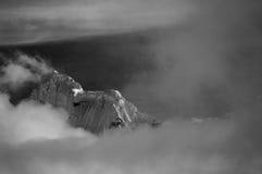 Chopicalqui peak above clouds Stock Photo