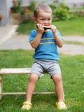 Chłopiec łasowania melon Zdjęcie Royalty Free