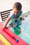 chłopiec bawić się piłka nożna stół Obraz Royalty Free