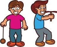 Chłopiec Bawić się Tradycyjnego zabawki Yo yo i bambusa Copter Obraz Stock