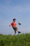 chłopiec futbolu bawić się Obraz Royalty Free