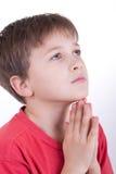 chłopiec ja modli się Zdjęcia Royalty Free