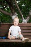Chłopiec na ławce Obrazy Stock
