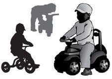 Chłopiec na zabawkarskim rowerze i samochodzie Fotografia Royalty Free