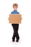Chłopiec trzyma deskę robić korek Obrazy Royalty Free