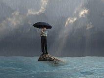 Mężczyzna z parasolem w powodzi Fotografia Royalty Free