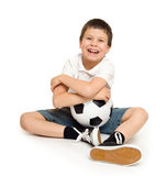 Chłopiec z piłki nożnej piłką Zdjęcia Stock