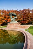 Chopin Monument in Warsaw. Chopin monument in autumn Lazienki Park in Warsaw, Poland, bronze statue of Polish composer and pianist Frederic Chopin, design from stock images