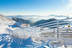 CHOPOK, SLOVAKIA - JANUARY 12, 2017: Fence covered by heavy snow on a sunny day after a heavy blizzard at Chopok mountain, January Royalty Free Stock Images