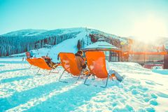 CHOPOK, SLOVAKIA - JANUARY 11, 2017: Many skiers relaxing in chairs near apres ski bar at Chopok downhill  in Jasna - Slovakia. CHOPOK, SLOVAKIA - JANUARY 11 Royalty Free Stock Images