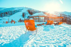 CHOPOK, SLOVAKIA - JANUARY 11, 2017: Skiers and snowboarders rel. Axing in apres ski bar chairs at Chopok downhill area - Slovakia Royalty Free Stock Image