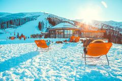 CHOPOK, SLOVAKIA - JANUARY 11, 2017: Skiers and snowboarders in apres ski bar chairs at Chopok downhill area - Slovakia. CHOPOK, SLOVAKIA - JANUARY 11, 2017 Royalty Free Stock Photos