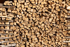 Chopped aspen firewood stacked up in a pile. Royalty Free Stock Image