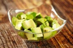 Chopped avocado on a wooden board Stock Photos