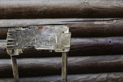 Chopped back of old stool behind the old wooden building. Top view. royalty free stock photos