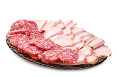 Chopped bacon and salami on a plate Stock Images