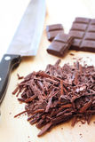 Chopped bar of dark chocolate Royalty Free Stock Images