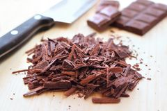 Chopped bar of dark chocolate Stock Image