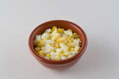 Chopped boiled eggs in a cup Stock Photos