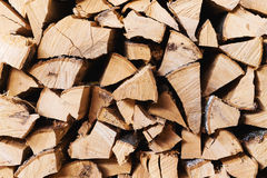 Chopped brown firewood, stacked and ready for winter Royalty Free Stock Photos