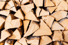 Chopped brown firewood, stacked and ready for winter Royalty Free Stock Image
