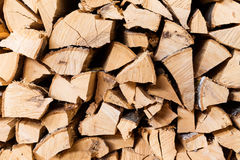 Chopped brown firewood, stacked and ready for winter Stock Images