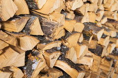 Chopped brown firewood, stacked and ready for winter Stock Photos