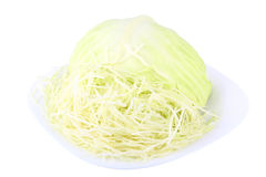Chopped cabbage. With shredded cabbage on a white background Stock Images
