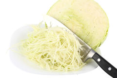Chopped cabbage. With shredded cabbage on a white background Stock Photos