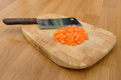 Chopped carrot and chopping knife on chopping block Royalty Free Stock Photography