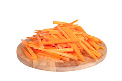 Chopped carrot sticks on the board isolated on white background Stock Photography