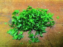 Chopped celery leaves on wooden background stock photos