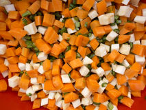 Chopped celery, parsnips, carrot and  celery stalk. Pile of mixed  healthy root vegetables, celery, parsnips, carrot and  celery stalk chopped for preparing a Royalty Free Stock Photo
