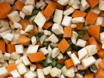 Chopped celery, parsnips, carrot and  celery stalk. Pile of mixed healthy root vegetables, celery, parsnips, carrot and  celery stalk chopped for preparing a Stock Images