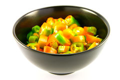 Chopped Chillis. In a black bowl with clipping path on a white background Stock Images