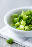 Chopped chive for salad. Freshly chopped chive in a small bowl royalty free stock photo